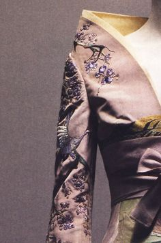 Alexander McQueen, spring 2005     Dress of lilac silk appliquéd with silk and embroidered with silk thread; jacket of lilac silk embroidered with silk thread. Photographed by Sølve Sundsbø for Alexander McQueen: Savage Beauty
