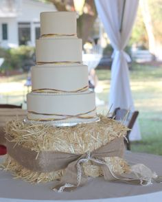 Round Wedding Cakes - Simple but perfect for this country farm setting.  The top 3 tiers are marble with buttercream