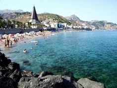 Giardini-Naxos beach in Sicily. This is where Grant visited his first beach for a couple of days.