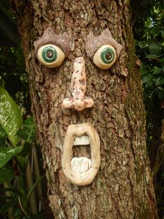 House down the street tree face decorations