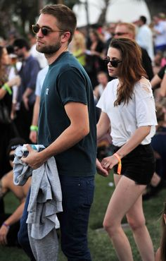 Robert Pattinson + Kristen Stewart at Coachella 2013 I love how they always are just barely touching....