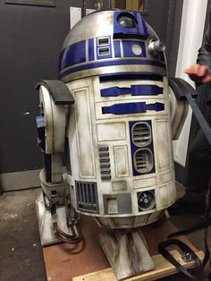 Star Wars: Episode VII officially wrapped production, and the film is ready to move forward into post-production. Thanks to a user on The RFP, we have some photos from the wrap party event that feature the R2-D2 droid unit that was actually used in the J.J. Abrams-directed movie.