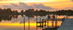 """The Inn at Tabbs Creek is a Chesapeake Bay waterfront retreat located in charming Mathews County Virginia. We are a modern and """"green"""" B that still celebrates our rich maritime history. Come and get away from it all...wake up to a delicious breakfast made from local foods, then embark on a kayak or stand up paddle adventure, bike ride, or lighthouse cruise on our deadrise boat. At the end of the day,enjoy a drink and sunset on our private dock, or relax in our eco-friendly pool. It's all…"""