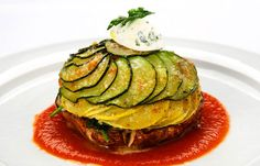 The Vegetarian Tower of Roasted Portobello, Zucchini Squash, Roasted Pepper and Spinach with Warm Goat Cheese Quenelle and Fennel Tomato Fondue is a sophisticated and elegant dish for a vegetarian option.
