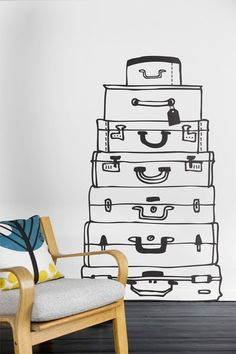 """""""Suitcases"""" wall sticker/ decal by Ferm Living -- way cheaper, more space saving, and graphically cooler than stacking LV trunks for decorative effect [and if you're into feng shui, this would go great in your """"travel & friends"""" corner]"""