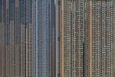 High density residential apartments in Hong Kong.  There are more than 6400 people packed in to every square kilometer, and in these high rises they live like dogs in cages.
