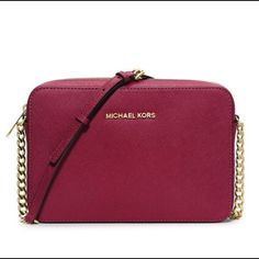 Michael Kors Jetset crossbody bag Michael Kors Jet set crossbody travel bag color cherry . Big enough to hold necessities , small enough to not weigh you down :) MICHAEL Michael Kors Bags Crossbody Bags