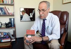 Dr. Sandler with his new book in his Albany, NY office