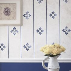Faux wallpaper created with stencils can be an easy way to decorate walls without using paper and glues.  Read more on how to create faux wallpaper.