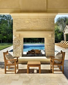 An outdoor two-sided fireplace serves as a window with a view and as the toasty center of the outdoor living room.