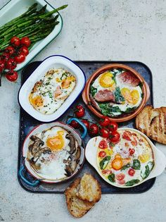 eggs – lots of ways Baked eggs – lots of ways! smoked salmon + chives, spinach + ham, tomato + basil and truffle mushrooms.Baked eggs – lots of ways! smoked salmon + chives, spinach + ham, tomato + basil and truffle mushrooms. Egg Recipes, Brunch Recipes, Breakfast Recipes, Cooking Recipes, Breakfast Ideas, Brunch Ideas, Soup Recipes, Cafe Recipes, Breakfast Buffet