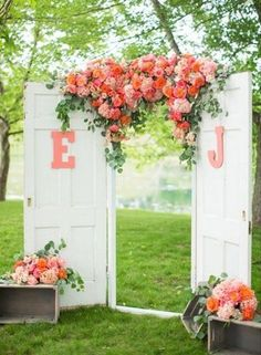 coral roses and white door wedding backdrop