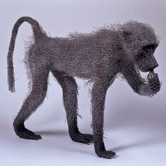 Juvenile Baboon Eating (2003) Animal Sculptures, Sculpture Art, Wire Sculptures, Subtractive Color, Monkey Tattoos, Baboon, Realistic Drawings, Wire Art, Clay Art