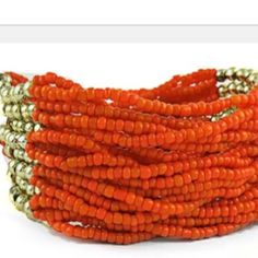 """Genuine coral bracelet with gold tone accents Genuine coral & gold tone bead, multi-strand stretch bracelet fits up to 8"""" wrist. Can be worn for casual or dressier events. New in package. Jewelry Bracelets"""