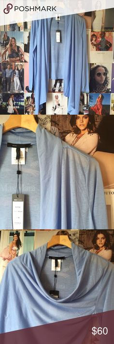 bcbgmaxazria + lightweight wrap Holy moly this sweater wrap is gorgeous! The color is a cloudless sky and the wrap option is maybe my favorite kind of garment ever. It's lightweight so easy to wear over another top. NWT. BCBGMaxAzria Sweaters Shrugs & Ponchos