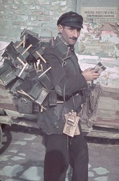 Warsaw, World War II | The Brink of Oblivion: Inside Nazi-Occupied Poland, 1939-1940 | LIFE.com. A peddlar in Warsaw, 1940 by Hugo Jaeger who was using color photography.