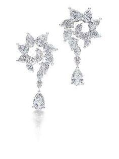 Harry Winston. Diamond and platinum earrings.