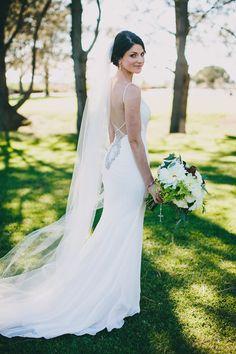 Love her backless dress! Such elegant lines!
