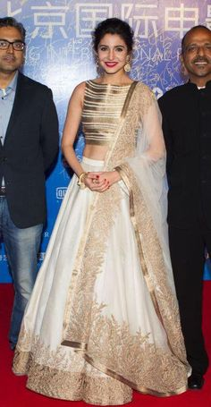 Anushka Sharma wearing a Gold and white designer anarkali.: Anushka Sharma wearing a Gold and white designer anarkali. Mode Bollywood, Bollywood Fashion, Indian Attire, Indian Ethnic Wear, Indian Wedding Outfits, Indian Outfits, Wedding Dress, Saris, Moda Indiana