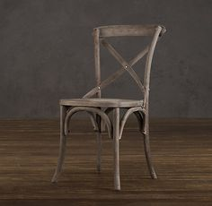 Madeleine Side Chair - dining chairs? Love the cane seat and the sculptural X back. Of course, the famous RH finish. LOVE.
