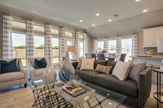 New Model Home Now Open in Austin's Teravista - 2,420 Sq. Ft. - Family Room & Morning Area - #PerryHomes #PerryHomesTexas #Teravista #GeorgetownISD #GeorgetownTX #Austin #AustinHomes #TexasHomes #trustedbuilder #homedecor #homedesign #moderndecor #modernhomedesign #landscaping #lakesidecommunity #lakeside #waterfront #lakefront #morningarea #breakfastroom #breakfastarea #wallofwindows #backdoor #backview #familyroom