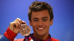 Bronze medalist Tom Daley of Great Britain poses with his medal for the Men's 10m Platform Diving