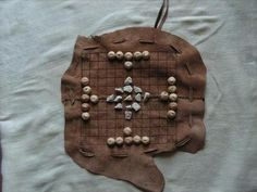 Hnefatafl viking board game by Glapsvidur on Etsy. The defending side comprises twelve soldiers and a king, who start the game in a cross formation in the center of the board. Their objective is for the king to escape by reaching any of the four corner squares.