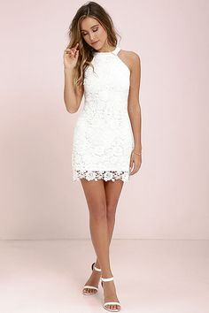 You'll be collecting notes from secret admirers right and left when you don the Love Poem Ivory Lace Dress! A lively pattern of floral lace creates an eye-catching overlay atop knit fabric. Halter neckline and darted sleeveless bodice transition into a chic, sheath skirt. Hidden back zipper with clasp.