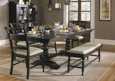 Jonas Dining Room SKU: PKGJA661T This cottage chic dining room collection is ideal for joyful family dinners and quiet Sunday brunches. Featuring birch veneers and a rich black cherry finish. Includes 1 x 20″ leaf.  The Upper Room Home Furnishings, Ottawa's Premier Home Furniture Store.