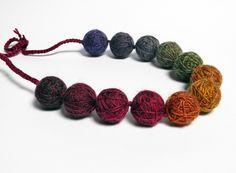 Ombré wool yarn beads necklace , shades of burgundy, mustard, green, purple. Fiber jewelry, yarn jewelry.. €35.00, via Etsy.