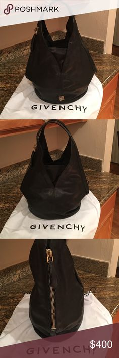 Authentic Givenchy Hobo Bag (Black) Givenchy Black Calfskin Tinhan Hobo Bag. The Bag has only been used a handful of times and looks almost brand new. 100% Authentic and I have the dust bag for it and looks brand new!! Givenchy Bags Hobos
