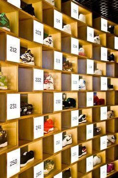 RETAIL Sneakerology knows it has quite the collection and plays to it with this unique number display technique. A computer screen gives you the features and benefits of each shoe by number. Signage Display, Shoe Display, Display Shelves, Shop Interior Design, Retail Design, Store Design, Clothing Store Interior, Computer Shop, Retail Merchandising