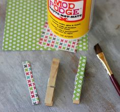 Mod Podge Paper onto clothespins