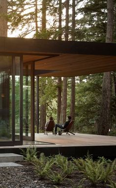 has designed this island retreat in the US state of which weaves its way between the site's tall douglas fir trees. Photo by Dream Home Design, Modern House Design, Modern Glass House, Wood House Design, House In The Woods, My House, Forest House, Interior Architecture, Concrete Architecture