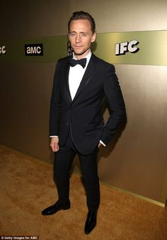 Over it: Meanwhile, Tom cut a solitary sight in a sharp-looking suit as he hit up the awards show without his now famous ex-girlfriend, Taylor