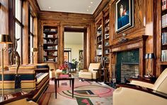 25 Distinctive Fireplaces : Interiors + Inspiration : Architectural Digest beautiful walls, bookshelves, fireplace, and cream chairs, I hate the carpet and striped couch though