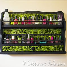 How to make a nail polish rack from an old spice rack, a can of spray paint and a roll of patterned duck tape. Includes tutorial and supplies list. #ducktape #crafts #upcycled