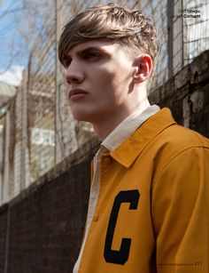 London menswear fashion editorial of male model in gold jacket, shot by London and Chicago based fashion photographer Petra Ford