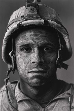 Face of War: U. Marine Carlos 'OJ' Orjuela was photographed by Louie Palu after a mission in Helmand province, Afghanistan.Look into his soul and learn what the word brace means