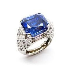 Single stone sapphire and diamond cluster ring by Cartier, Paris, the cut-corner rectangular Ceylon sapphire, 17.55ct,