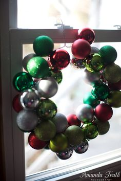 DIY Christmas ornament wreath- just add a beautiful bow!! And the ornaments are reusable, no hot glue needed!! What a great craft for kids!!!