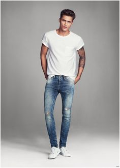 """Skinny Denim Jeans–H&M hones in on its men's denim for a new shoot featuring British model Harvey Haydon. The Swedish brand reunites Harvey following last spring's denim outing. Connecting with Rachel Wirkus, H&M features the stylist's favorite denim styles. Highlighting H&M's skinny and super skinny denim fits, Wirkus shares, """"I love a man in denim, especially a well-fitting denim jean."""" Related"""