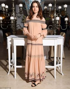 Sensational: Lily Collins, 28, looked stunning in a pale coral Bardot dress which showcase...