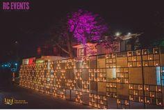 stunning candle wall , lavish candle decor , opulent and grand decor , lit up , dazzling decor ,