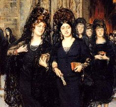 Women in traditional black Chantilly lace mantillas with large combs worn in Spain for Holy Thursday.