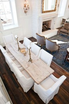 Lovely farmhouse style dining room table.. love how long it is & the light wood used.