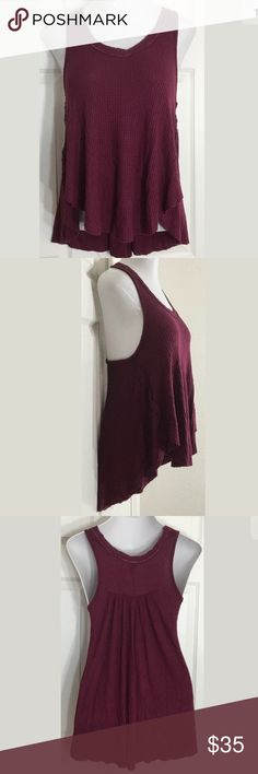 """Free People Burgundy•Sleeveless•Hi-Low•Tank Top Cute loose, waffle knit, wine colored tank top. Bust: 38""""; Length in the back from the shoulder: 27"""". Smoke free home. Thanks for shopping my closet 🌺! Free People Tops Tank Tops"""