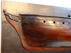 Detailed image of a great shipbuilder's half hull model. Not often the maker takes the time to also depict the figurehead, bowsprit and keel.