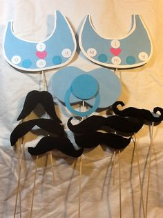 Amazing what some cardstock, foam board, and fleece can get you.  Baby Shower Photobooth props I handmade...Bibs, pacifier, and mustaches!