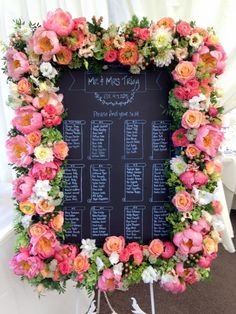 Coral flowers including roses, peonies and dahlias for table plan centrepiece by Catherine Gray Flowers